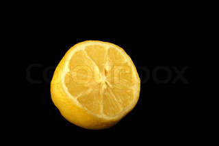 half of fresh lemon on the black background