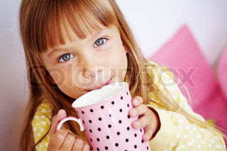 Kid girl drinking milk from cup