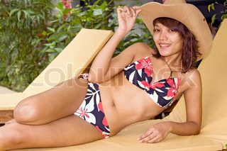 Young woman on deck chair