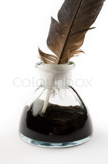 Feather and ink bottle isolated on white
