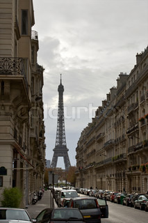 Street with a view to Eiffel Tower