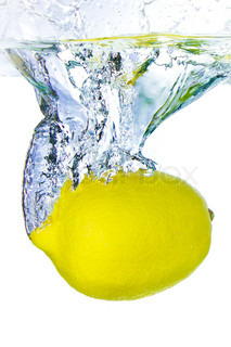 ripe lemon splashing water isolated on white background