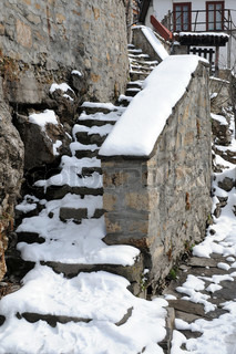 Medieval stone steps and banister under snow