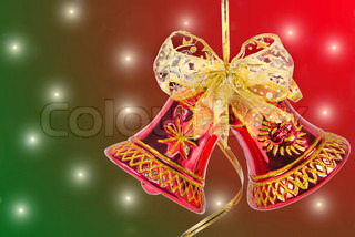Christmas bell with red ribbon against light background