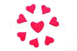 Painted to pink hearts of plasticine on background