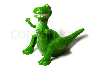 green toy dinosaur isolated on a white background