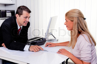 husband and wife in a counseling session in an office