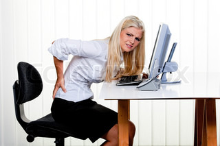young woman with pain in the back office