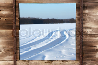 view from wooden window on winter landscape
