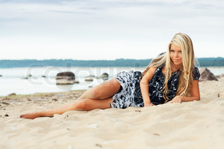 Young sexy girl laying on a beach