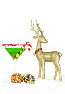 A christmas drink, with red and purple baubles and golden reindeer decorations on snow