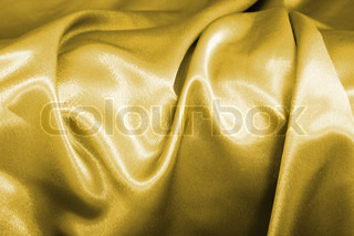 old velvet background in the gold color