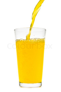 orange juice pouring into glass on white background