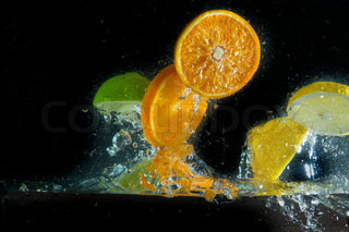 fruit splashing in the water