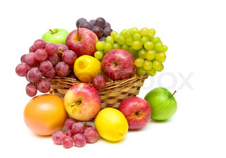 still life of fruit in a wicker basket on a white background