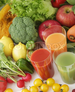 Glasses of fresh juice from different fruit