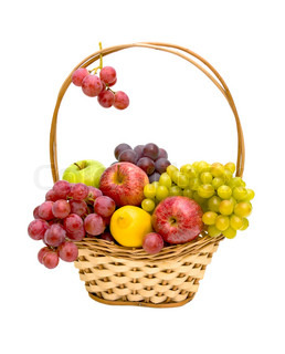 Still life of fresh fruit in a wicker basket isolated on white background