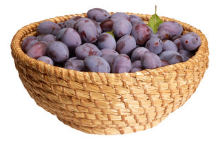 a basket with plums in white back