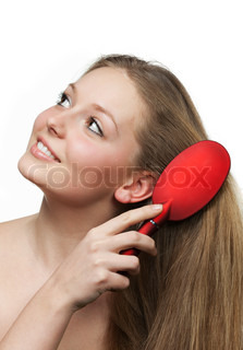The girl with long hair and a hairbrush It is isolated on a white background