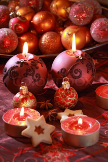 Detail of delicious Christmas cookies with candles in violet tone