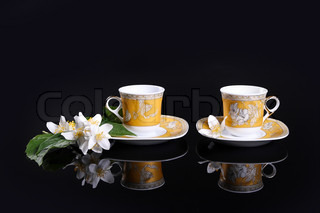 yellow cups on black with jasmine flower