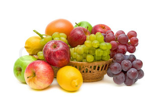 fresh fruit in a basket isolated on white close-up