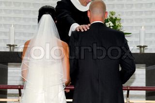 Bride and groom is being married by prist