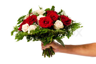 A womans hand is holding a bouquet of flowers isolated on white background