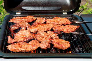 outdoor grilled pig meat on grill