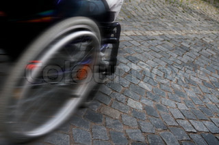 speed - detail wheelchair on cobblestones