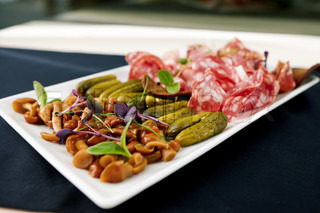 Snacks of vodka choice of Italian meat, mushrooms and marinated pickles