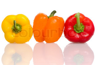 Three fresh peppers on white background