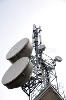 Communication tower with satellite dishes and aerials