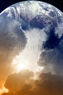 Planet Earth in space, sky with clouds and bright sun