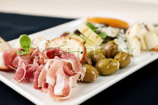 Snacks selection for wines Parma ham, olives, cheese