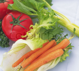 Green leafy lettuce, tomatoes, carrots isolated on white