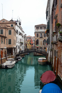 architecture of Venice, canal with parked boats and colorful buildings