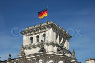 German national flag on the top of Reichstag Building in Berlin