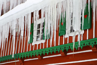 Red old wood windows with icicles