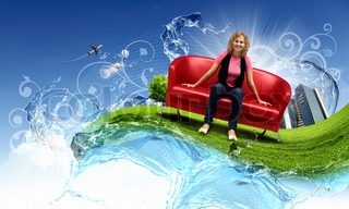 Young woman sitting on a red sofa and nature background behind her