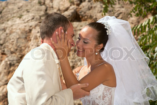 Happy married couple Photosession on open air in a landscape of mountains of Crimea