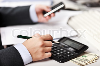 Working business man hand pen writing paper document at office workplace