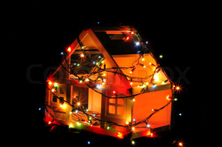 christmas house with color lights in the dark night