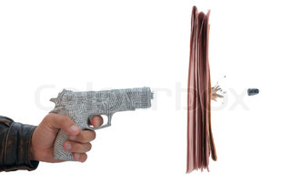 male hand with fire a shot newspaper pistol and bullet with break newspaper on white background fake