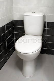 White Toilet With Black Seat. Modern clean toilet bowl  white ceramic with White open seat cover Stock Photo