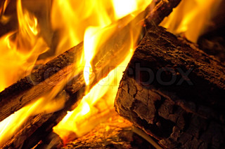 hot fireplace full of firewood and fire