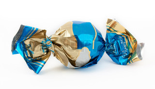 Candy in the sweet wrapper isolated on white