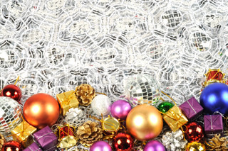 Christmas border with colorful balls , gifts and fir golden cones