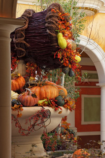 Beautifully decorated lobby luxury hotel Celebration of harvest: baskets and vases with colorful gourds, flowers and autumn leaves