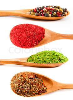 set of spices in a wooden spoons isolated on a white background